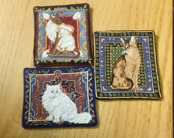 Miniature carpet or tapestry for dollhouse, with cat embroidered at petit point on silk gauze.
