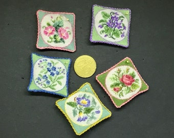 Miniature dollhouse cushion with antique bouquet embroidered at petit point on silk gauze. 1:12 scale