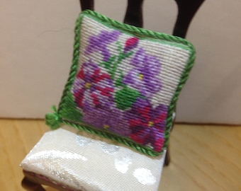 Miniature cushion for dollhouse embroidered at small point.