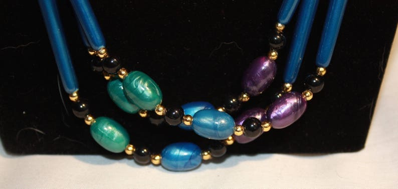 3 Stranded Purple and teal blue peacock colored  necklace