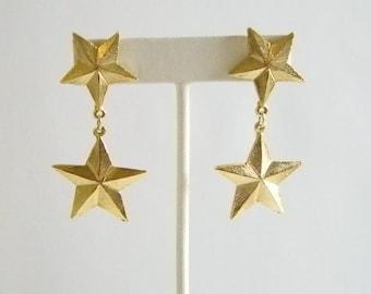 Long Gold Tone Textured Star Dangle Pierced Earrings