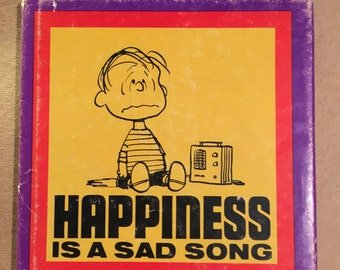 First Edition Schulz, Charles M. Happiness is a Sad Song 1967