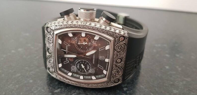cd974970fc36 Emporio Armani AR-4900 Supermeccanico mano grabado reloj de