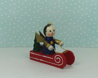 Vintage angel sled Christmas ornament blue red 1960s