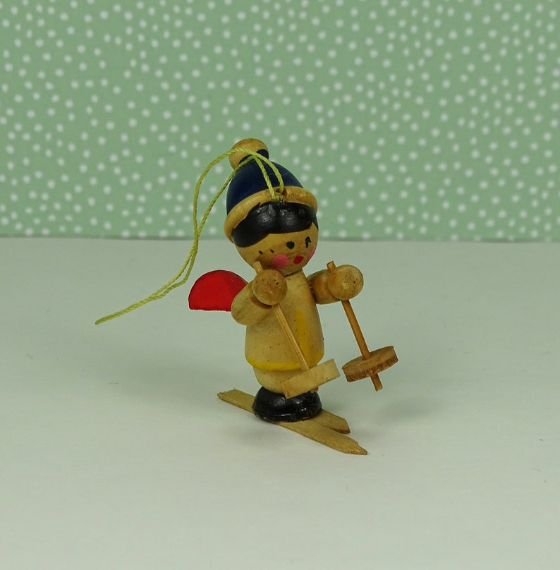 Vintage skiing angel Christmas ornament 1960s wooden blue red
