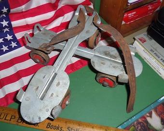 Vintage Mid-Century adjustable clamp-on roller skates with key