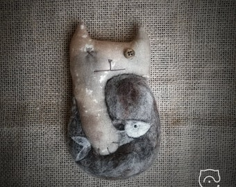 Cat with fish in a rustic style. Sewn and felted. Tinted cotton, wool.