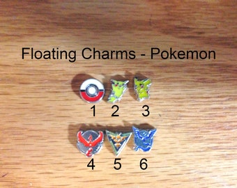 floating charms, Pokemon Charms, yellow guy, badges, poke ball, blue-grey guy,