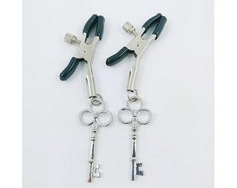 Bdsm key nipple clamps. Sissy stripper luxe fetish kinky.
