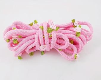 Pink rose bondage rope. bdsm ddlg