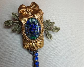 Re-purposed, upcycled assemblage vintage style key pin brooch with bow, leaves and blue rhinestones