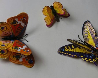 Set of three 3D butterfly hair clips.