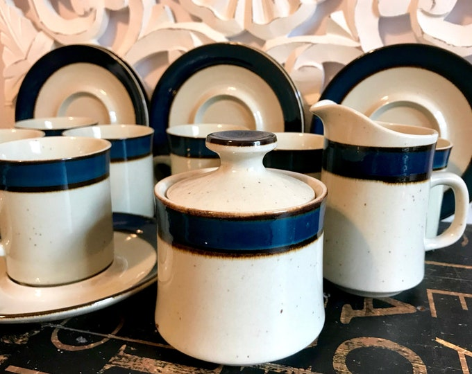 Rainbow/Sango Mugs, Saucers, Covered Sugar and Creamer Mariana Pattern Speckled Stoneware with blue band sandwiched between two brown lines