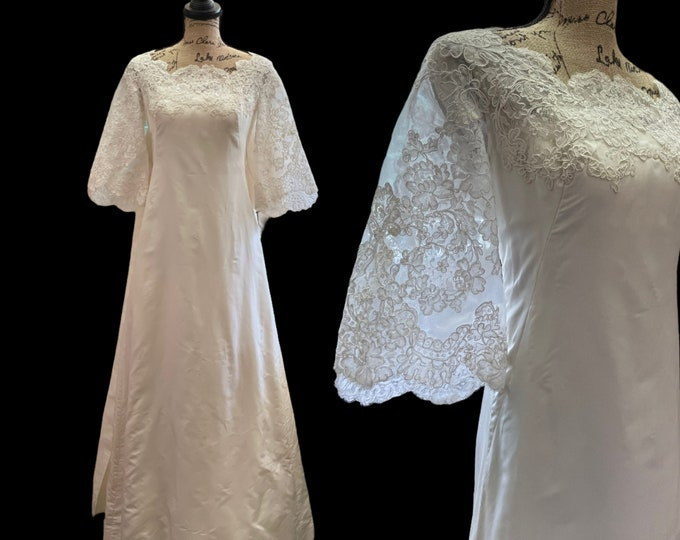 Stunning 1960s A-line Wedding gown w/ Alencon lace bodice, bell sleeves and bustling chapel train with bow accent