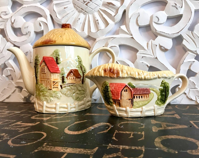 Marks and Rosenfeld Vintage Ceramic Teapot and/or Gravy Boat. Raised design of a farm scene w/thatched roof tops and rail post fence bottom