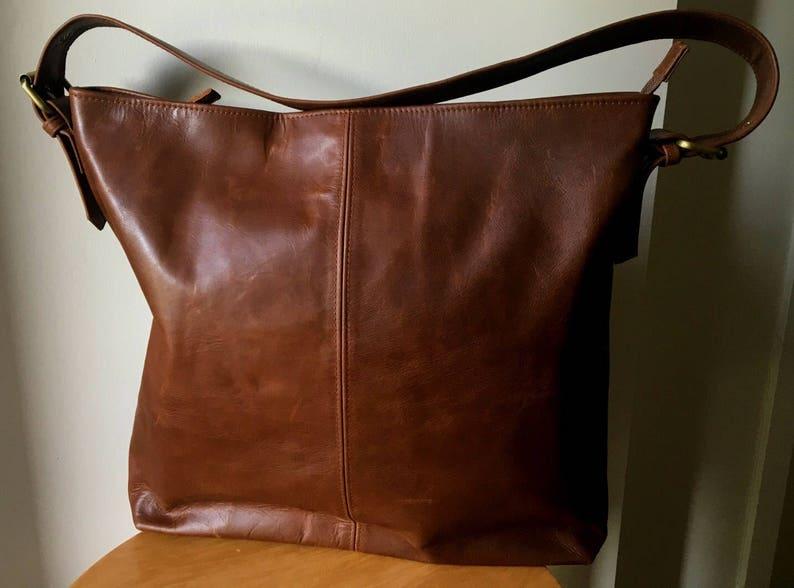 5b8991b27d Simple and classy leather handbag with single strap.Handmade