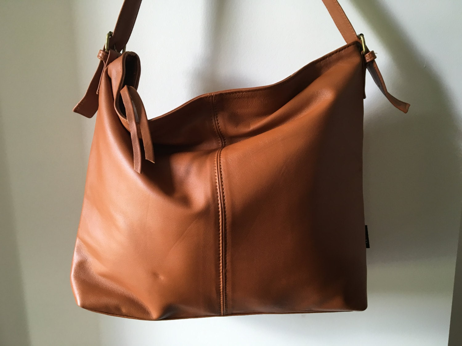 ea7c86b816a Leather Tote shoulder bag.Single strap,adjustable belt features.Quality,  soft, shoulder bag. Real leather with long strap.Classic and simple