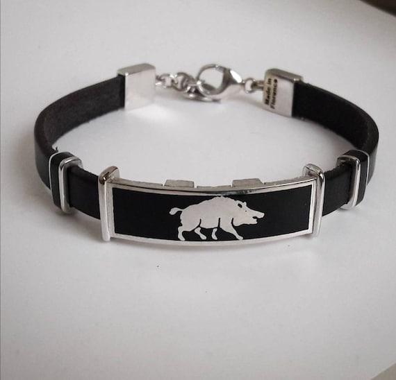 Bracelet in silver black enamel and leather. Boar design