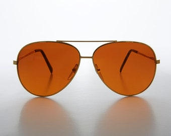3421d5ddde3 Large Metal Aviator Sunglass 64mm with Blue Blocking Amber Lens - Cruise