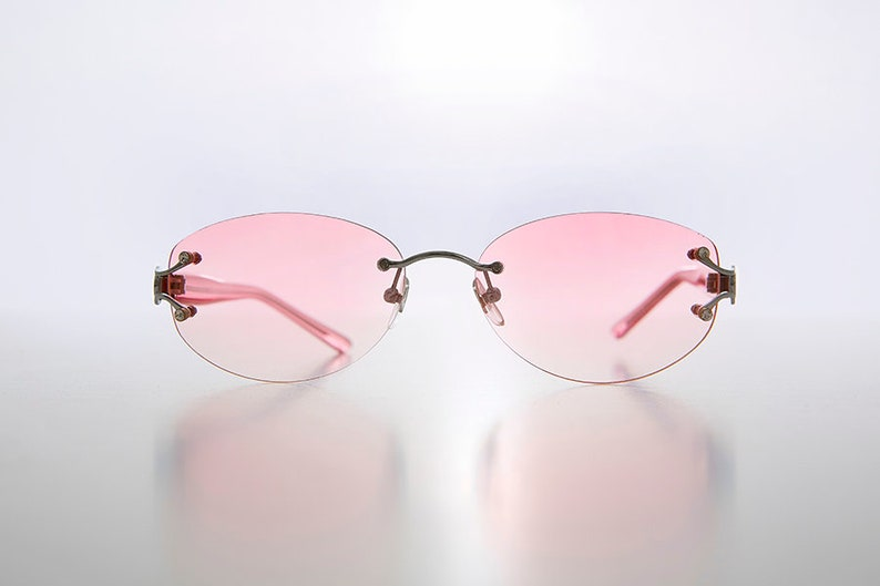010e224215 Rimless Oval Sunglass with Rhinestone Accents Color Tinted