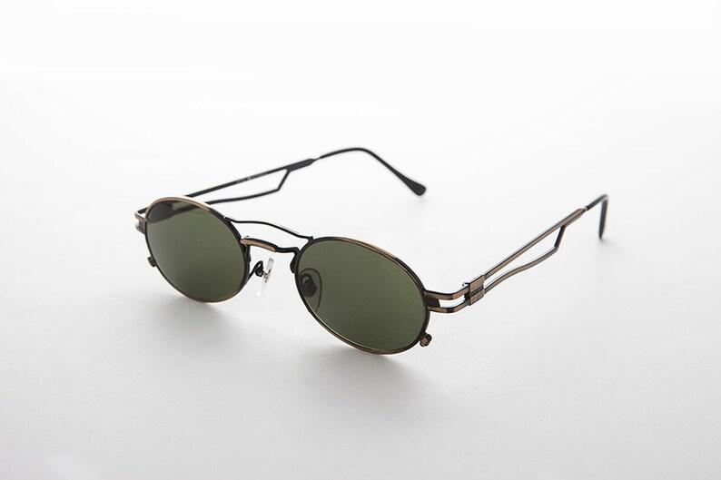 f76d5948ce Sportif ovale steampunk vintage des années 90 lunettes de | Etsy