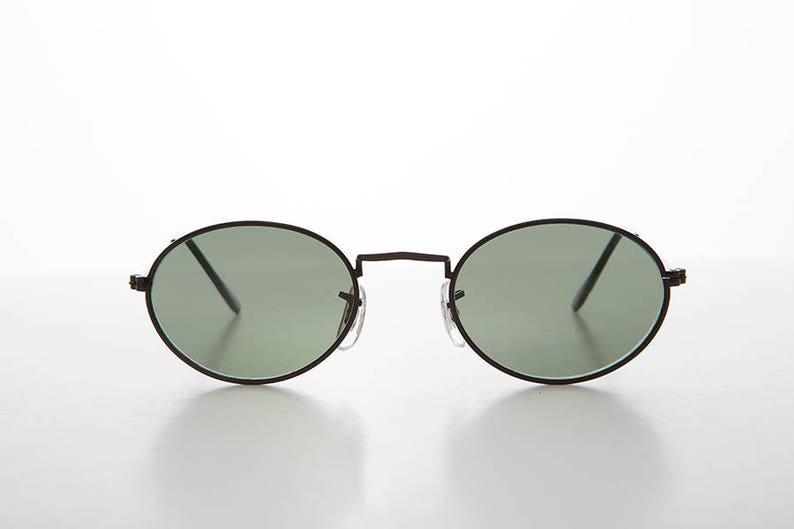 aa8b7ea79f Cadre métallique ovale lunettes de soleil Vintage des années | Etsy