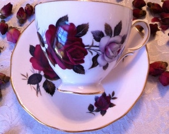 Tea Cup And Saucer  With Red And White Roses