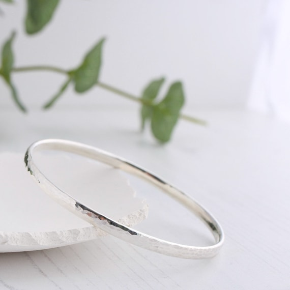 Hammered silver bangle - oval profile round bangle handmade in solid sterling silver with a hammered texture the perfect stacking bangle