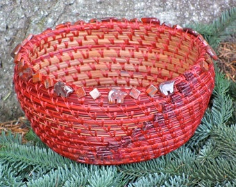 """Lovely brown and red pine needle basket with poppy jasper Zuni bear and square beads and a reddish brown agate center entitled """"Redwoods""""."""