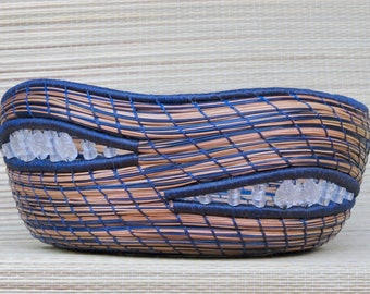 """Extrodinary pine needle basket with sea glass sand dollar beads and dark blue crystallized agate in resin base entitled """"Pacific Treasures""""."""