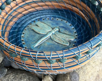 """Beautiful blue and brown pine needle basket with teal blue lava beads and a 3-D blue dragonfly pottery base entitled """"Summer Pond""""."""