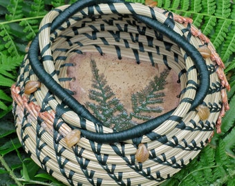 """Unique natural brown and green pine needle basket with Czech topaz leaf glass beads and a green fern pottery base entitled 'Woodland Ferns""""."""