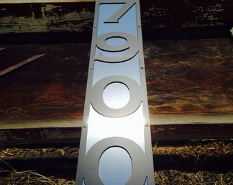 Address sign with stainless steel accents.