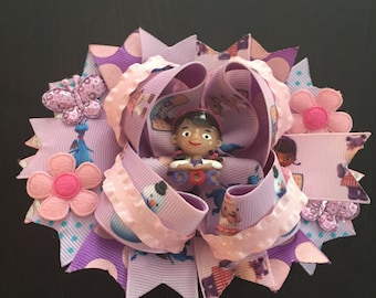 Doc McStuffins boutique hairbow with an attached barrette on the back