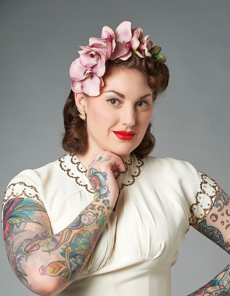 1940s Hair Snoods- Buy, Knit, Crochet or Sew a Snood     Vintage Style Phalaenopsis Orchid Cascade Head Piece Pin Up Hair Flower 4 Colours Available $22.89 AT vintagedancer.com