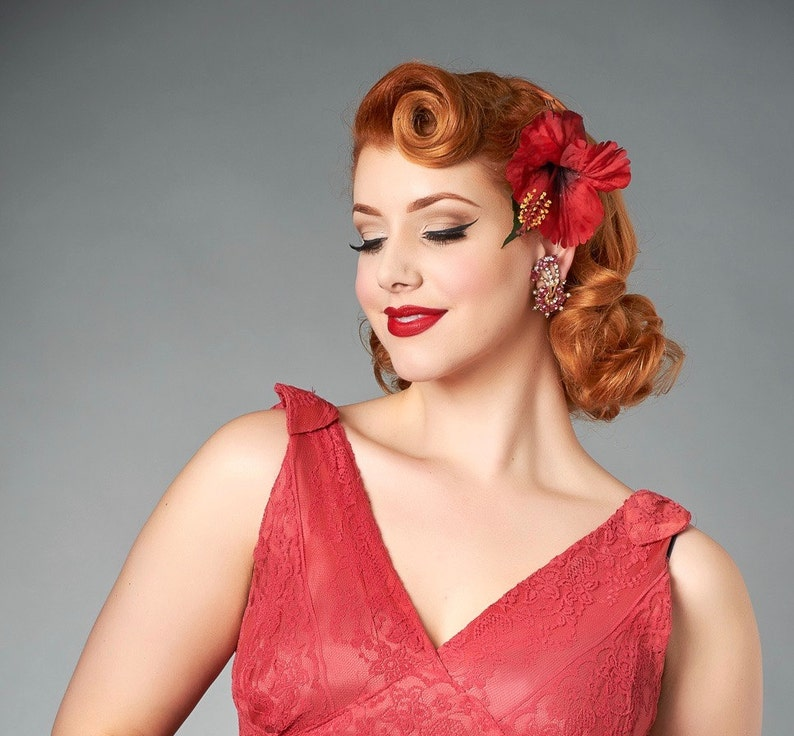 1940s Hairstyles- History of Women's Hairstyles Red Hibiscus Pin Up Hair Flower $9.83 AT vintagedancer.com