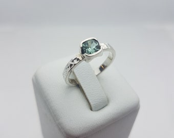 silver ring and green tourmaline