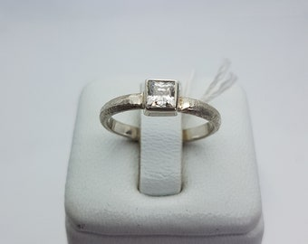 silver ring and square zirconium oxide