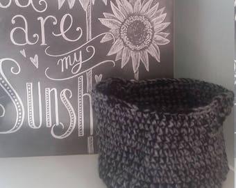 Gray and black handmade crocheted basket.