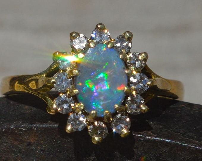 Featured listing image: 18ct Gold Solid Black Opal and Diamond Halo Ring, Lightning Ridge Opal