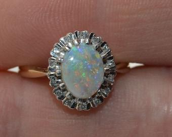 Large 18ct Gold Australian Opal and Diamond Halo Ring