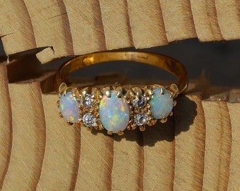 18ct Gold Opal Rings