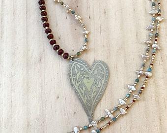 Whimsical heart pendant