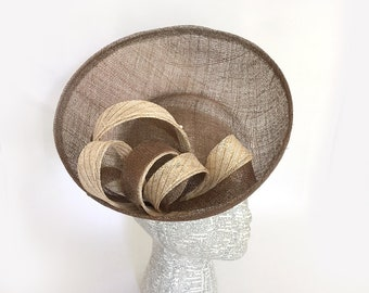 Brown sinamay saucer fascinator with ivory and gold bows