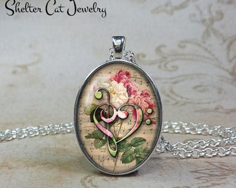 """Treble Clef and Bass Clef Heart Necklace - 1""""x1-1/4"""" Oval Pendant or Key Ring - Music Note Jewelry - Gift for Singer, Musician, Song Writer"""
