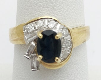 Blue Sapphire with Baguette and Round Diamonds Yellow Gold Ring