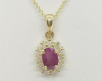 0.83 Cttw. Ruby in Diamond Halo in 14K Yellow Gold by Luxinelle