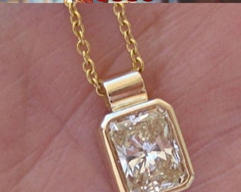 0.59 Carat Radiant Cut Bezel Diamond Solitaire Pendant on a Chain - 14K Yellow Gold