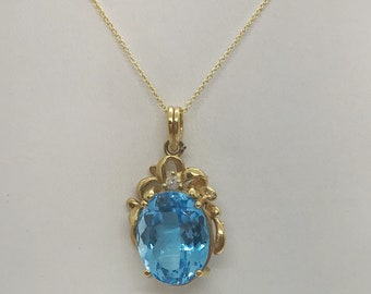 11x17mm Oval Blue Topaz Pendant with Accent Diamond in 14K Yellow Gold - 18.45 TCW