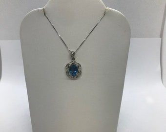 Oval Blue Topaz in Diamond Halo Pendant Necklace in 14K White Gold by Luxinelle